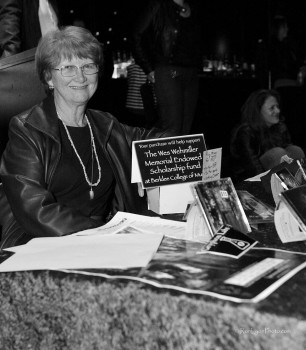 Nancy Ekman, overseer of the merch table