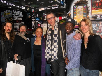 The WesFest committee and scholarship recipient Joshua Tyson share in a photo op backstage with Pino Palladino