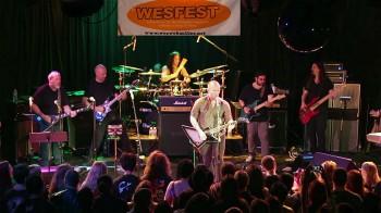 Group shot of Galaktikon playing live (L to R: Mike Keneally (gtr), Jude Gold (gtr), Tim Yeung (drums), Brendon Small (gtr/vox), Rick Musallam (gtr), Bryan Beller (bass) - photo by Dave Foster