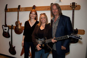 Epiphone contest winner (L to R: Stacey Ferguson (event co-producer), Robbin Burton (contest winner), Peter Leinheiser (of Epiphone) - photo by Erin Fotos